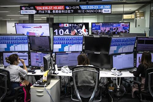 Chứng khoán châu Á rời các mức cao, lợi suất với các kích thích kinh tế từ Mỹ