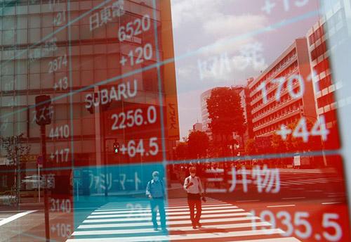 Chứng khoán châu Á lao dốc trước lo ngại về sự phục hồi toàn cầu; tập trung vào kích thích tài chính Hoa Kỳ